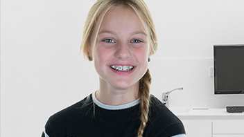 About Smiles Dental Centres - Toddler wearing braces